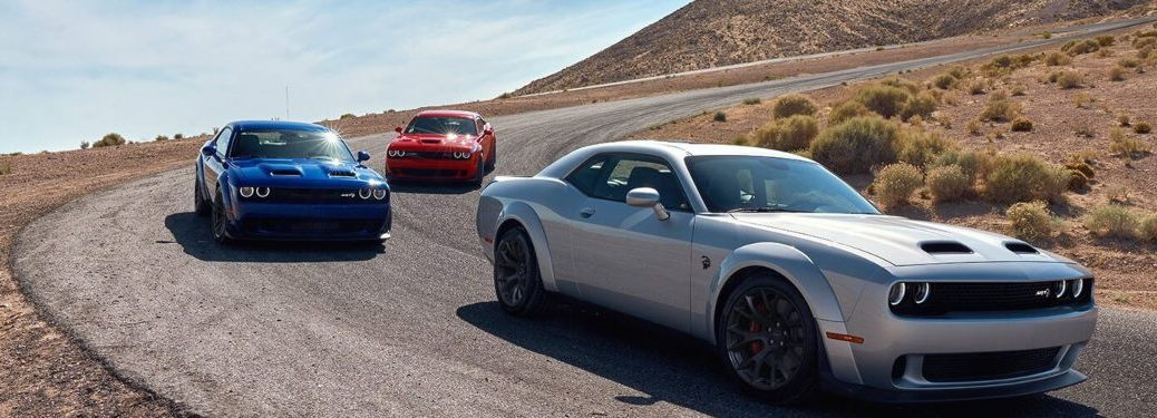 2020 Dodge Challenger models driving down a mountain road
