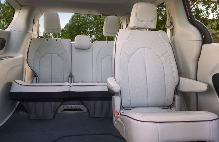 Second and third rows of seats behind the 2020 Chrysler Pacifica
