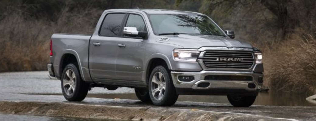 A silver-colored 2021 RAM 1500 parked near water