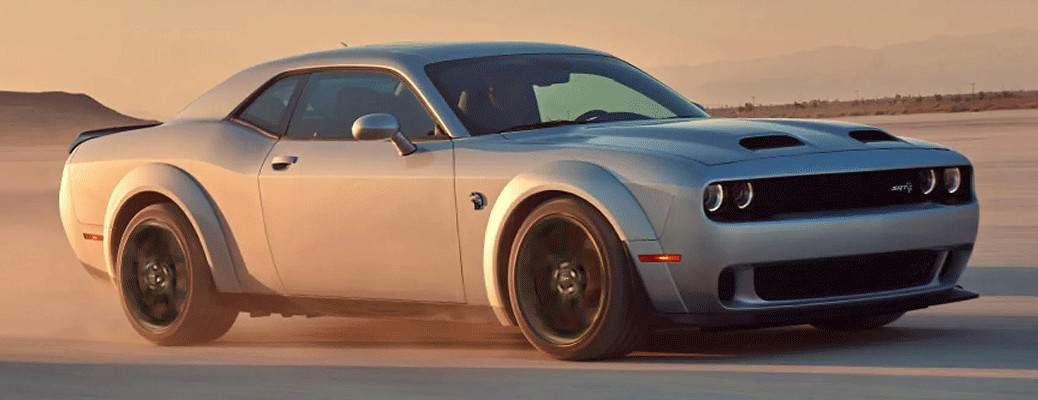 A silver-colored 2021 Dodge Challenger driving outside