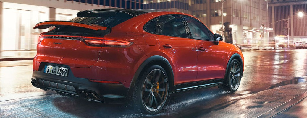 rear view of the 2020 Porsche Cayenne driving in city