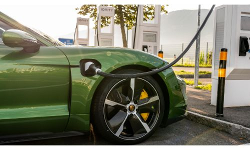 2020 Porsche Taycan green charging at charging station