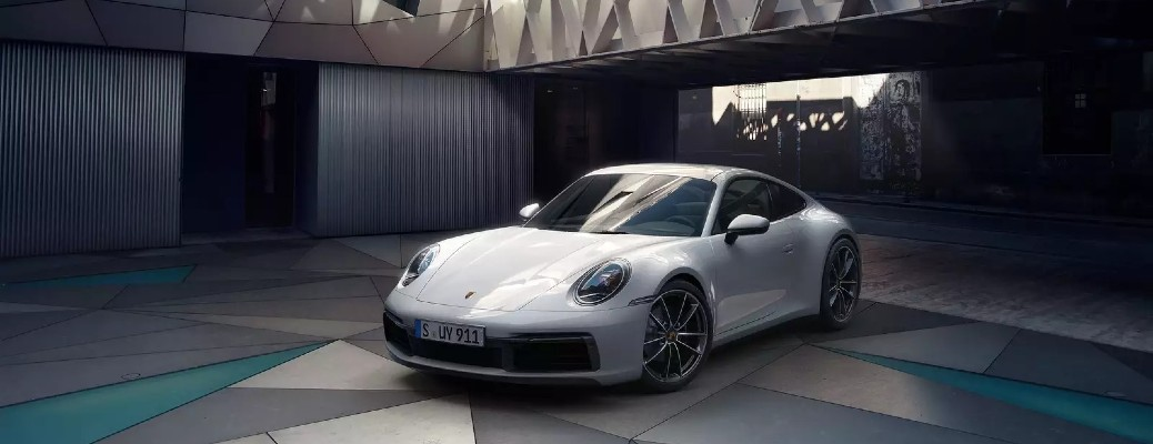 The front view of a white 911 Targa 4S Heritage Design Edition.