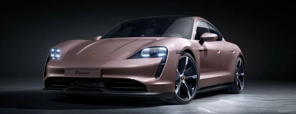 What is the range of 2021 Porsche Taycan electric?