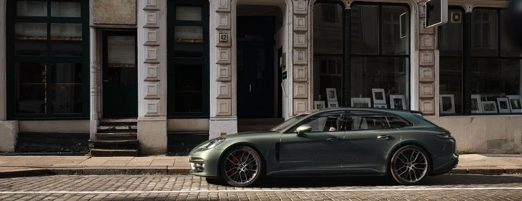 Green 2022 Porsche Panamera parked on the side of a road. What are the key features?