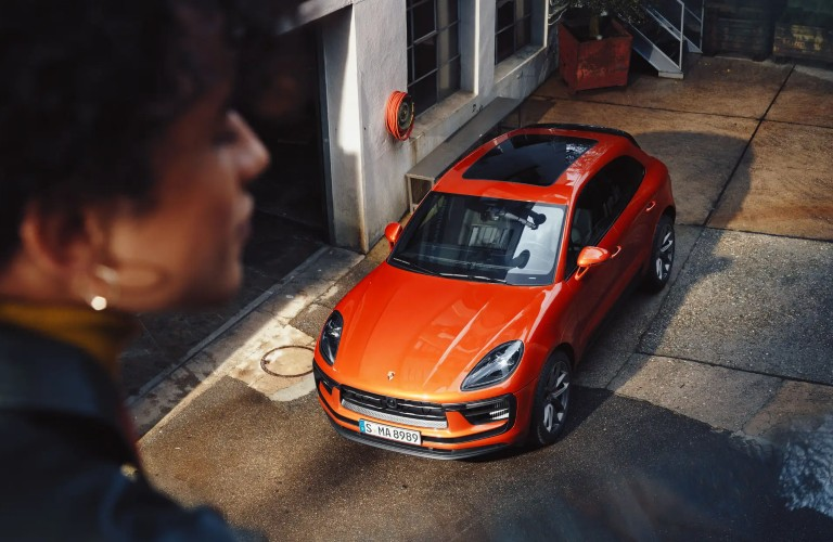 Front driver angle of an orange 2022 Porsche Macan
