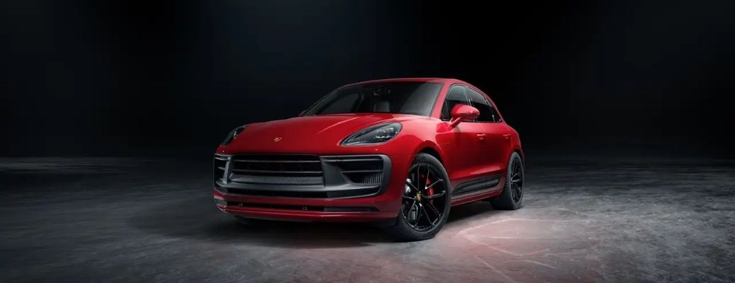 Front view of a red 2022 Porsche Macan under moonlight. What are the engine specifications?
