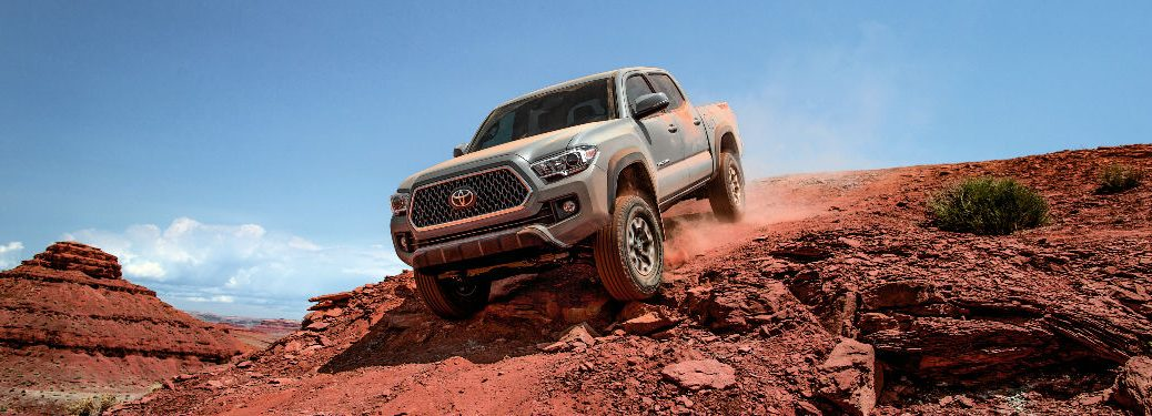 2018 Toyota Tacoma Exterior View in Silver Driving Down a Dirt Hill