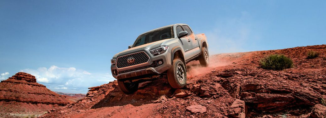 toyota tacoma parked on dirt and rocks