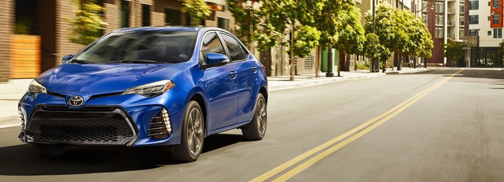 2018 Toyota Corolla Exterior View Driving Down Street in Blue