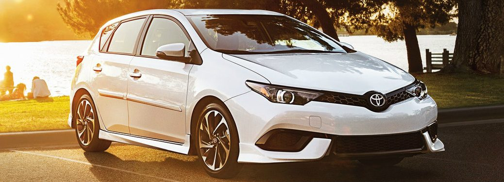 white 2018 Toyota Corolla iM parked at lake