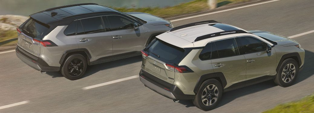 Two 2019 Toyota RAV4 Models in Silver Coloring Exterior View of Rear End and Side