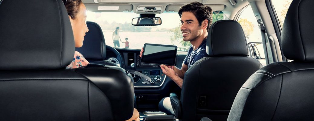 2018 Toyota Sienna Interior with People in Front Seats