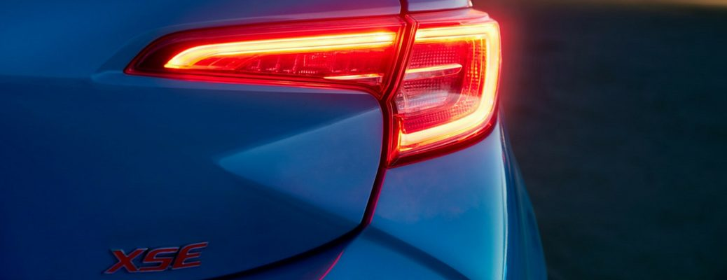 2019 Toyota Corolla Hatchback Rear View of Blue Flame Exterior with XSE Badge
