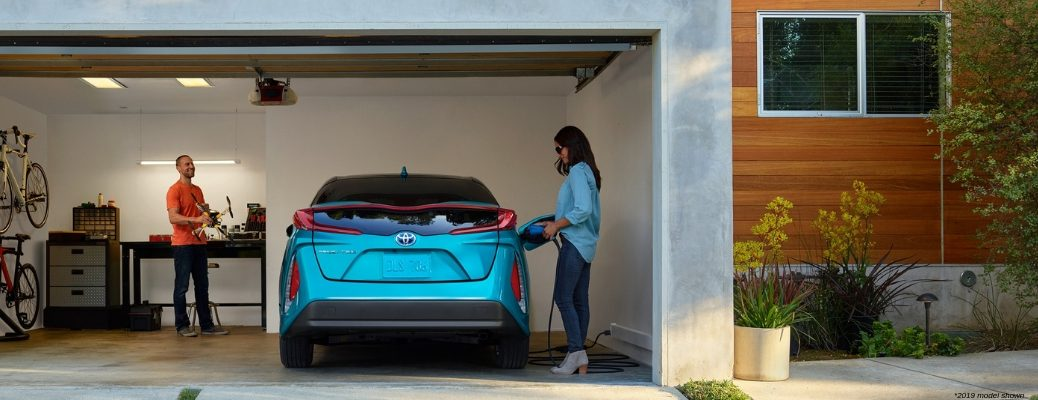 Blue 2019 Toyota Prius Prime charging in garage
