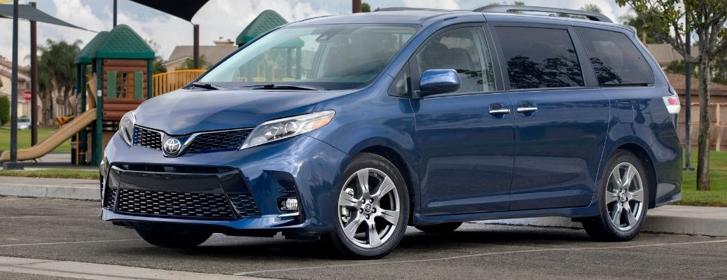 Blue 2019 Toyota Sienna in front of park