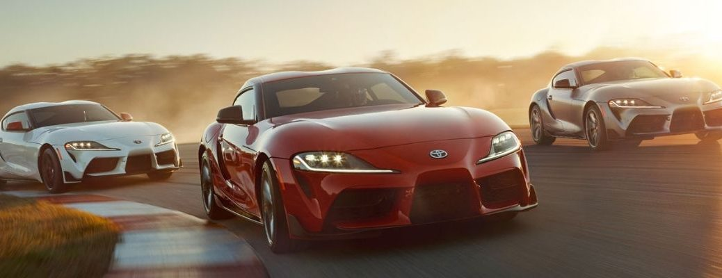 Lineup of three 2020 Toyota Supra vehicles driving