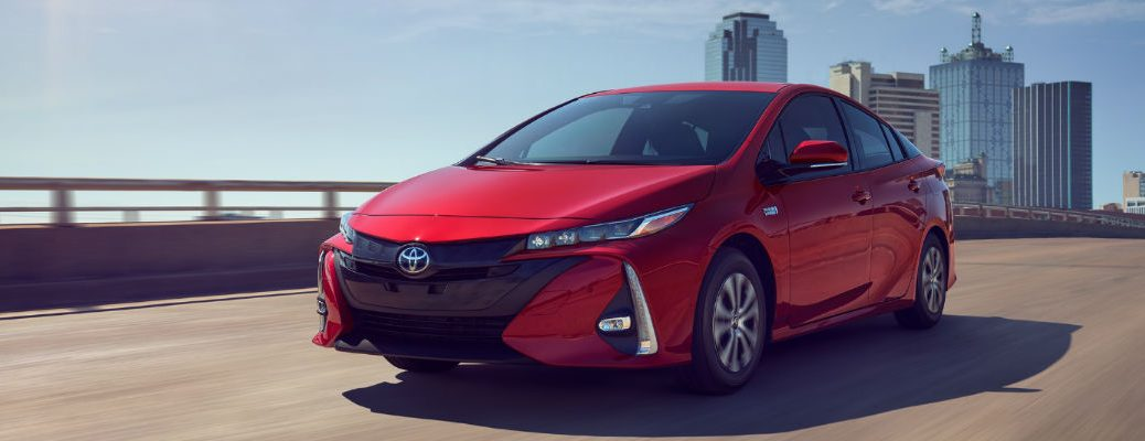 Red 2020 Toyota Prius Prime driving