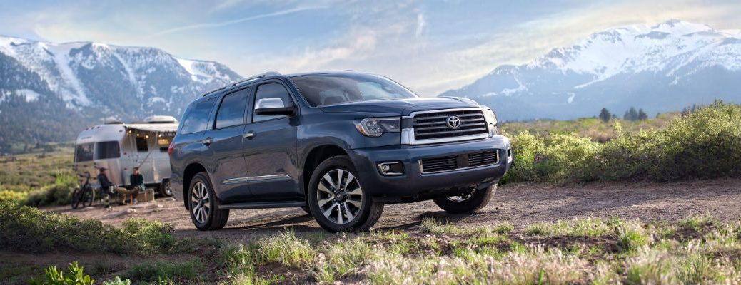 Blue 2020 Toyota Sequoia in front of camper