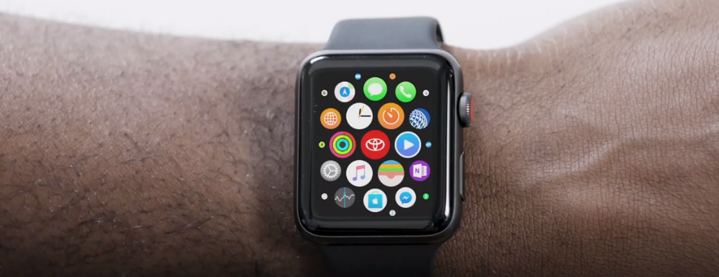 Arm wearing Apple Watch with app icons displayed on screen
