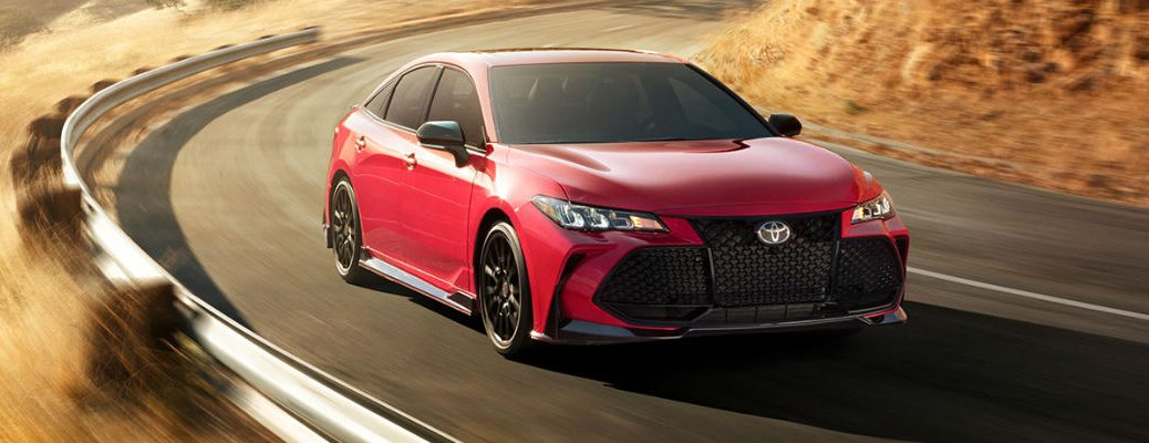 Red 2020 Toyota Avalon driving down road