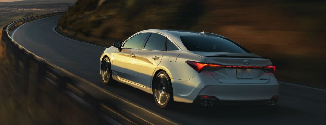 Rear view of 2020 Toyota Avalon driving