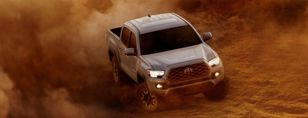 Grey 2020 Toyota Tacoma driving through desert