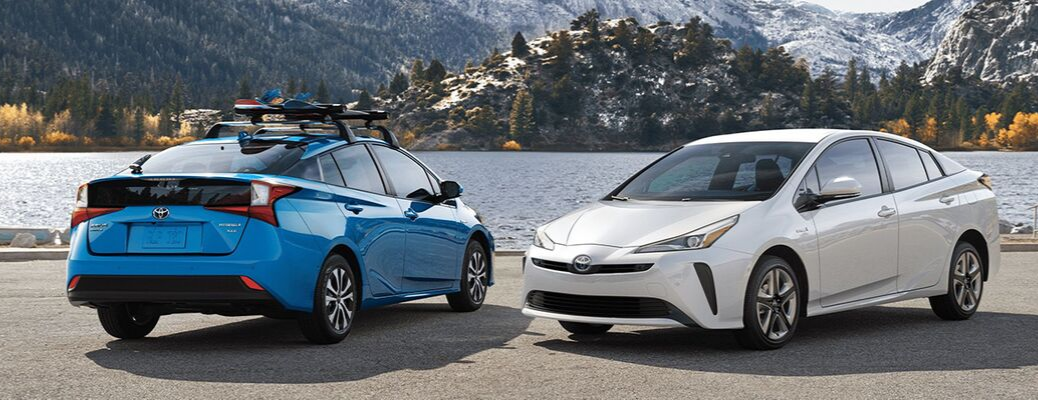 Blue 2020 Toyota Prius model and white 2020 Toyota Prius model