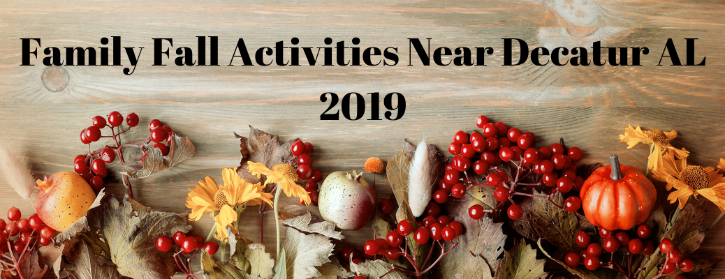 """Wood background with fall decor and """"Family Fall Activities Near Decatur AL 2019"""" black text"""