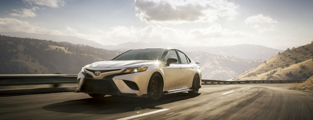 White 2020 Toyota Camry driving