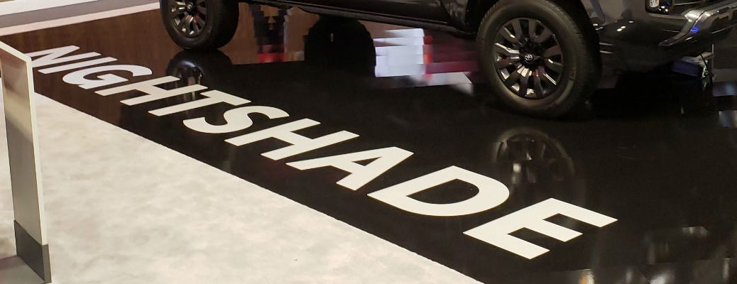 A photo of the Nightshade sign used at the Chicago Auto Show.