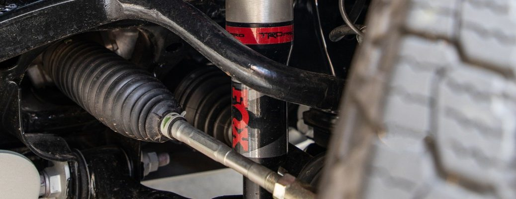 A photo of a TRD shock absorber attached to a Toyota vehicle.