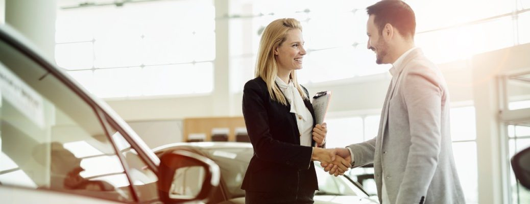 A stock photo of a customer shaking hands with a sales person.