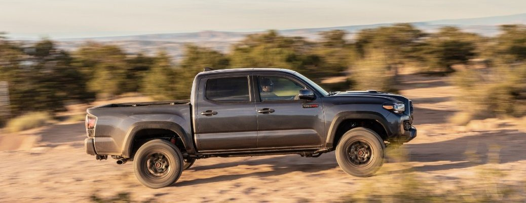A left profile photo of the 2020 Toyota Tacoma in the desert.