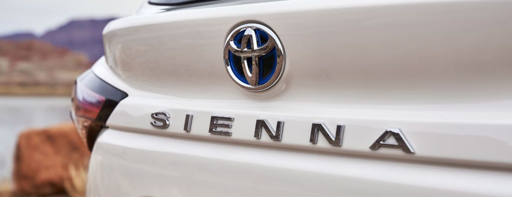 A close up photo of the Sienna badge used on the hybrid version of the 2021 Toyota Sienna.