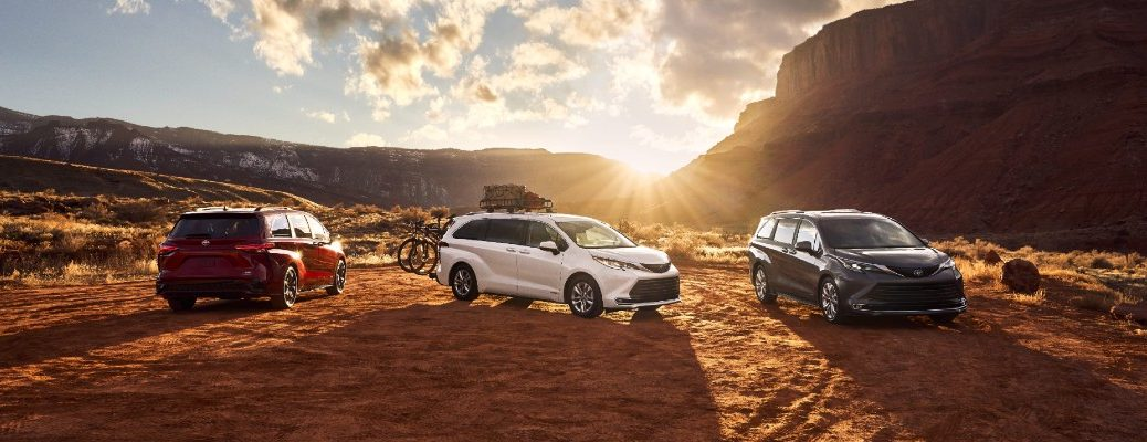 A photo of three 2021 Toyota Sienna models by some mountains.