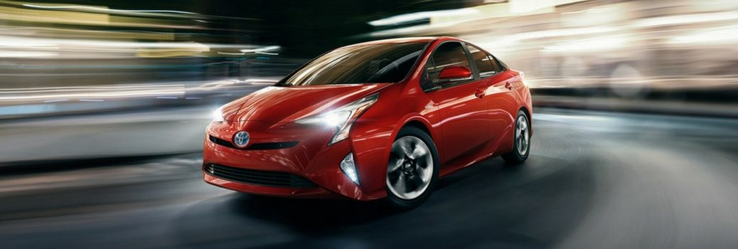 2018 Toyota Prius driving down road.