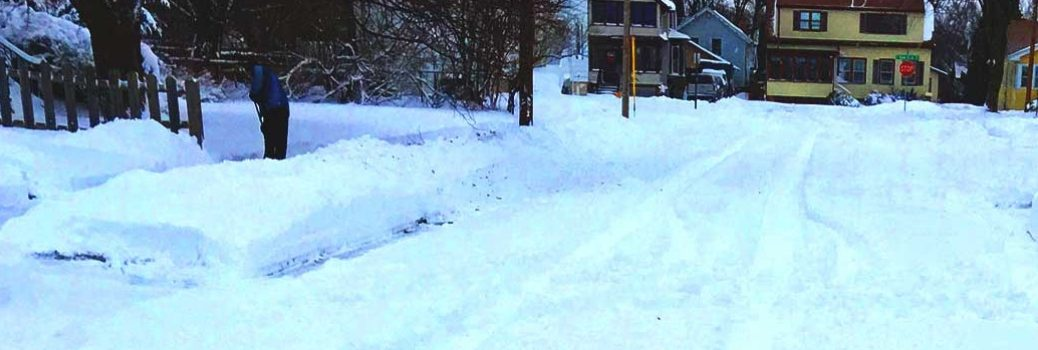Winter road and sidewalk and terrain