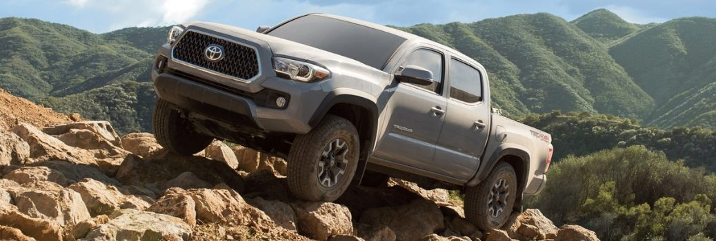 2019 Toyota Tacoma driving on the rocks
