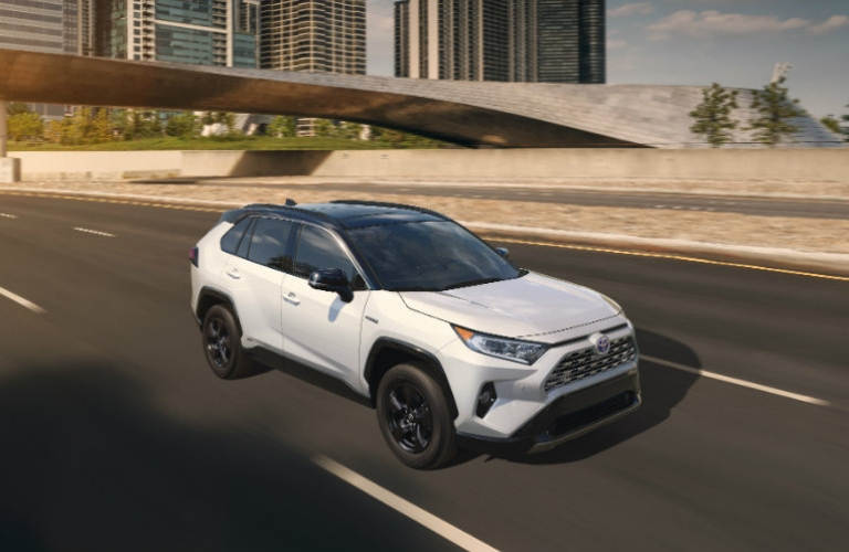 2019 Toyota RAV4 driving down a road