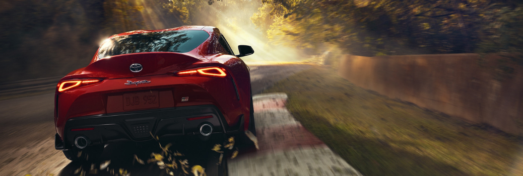 2020 Toyota Supra driving on the road at dusk