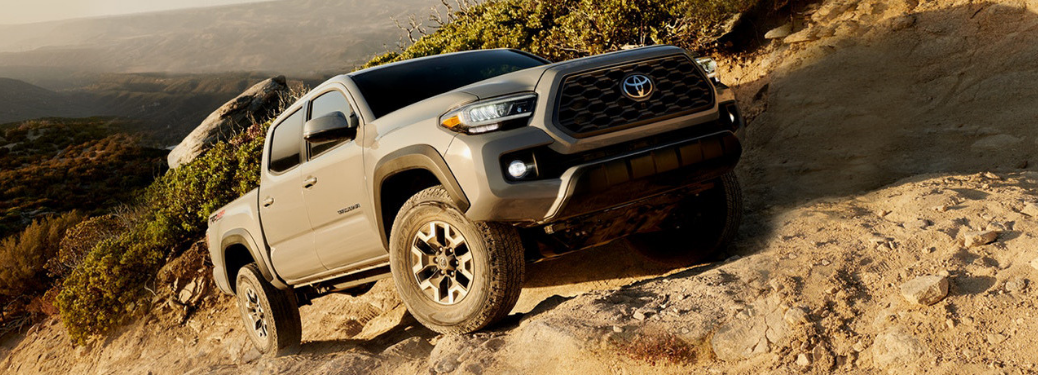 2020 Toyota Tacoma driving on the rocks and dirt