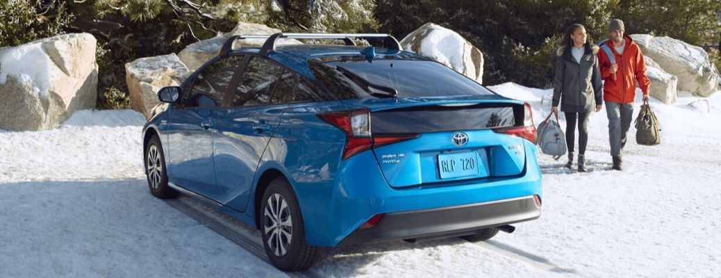2020 Toyota Prius driving on the snow with people
