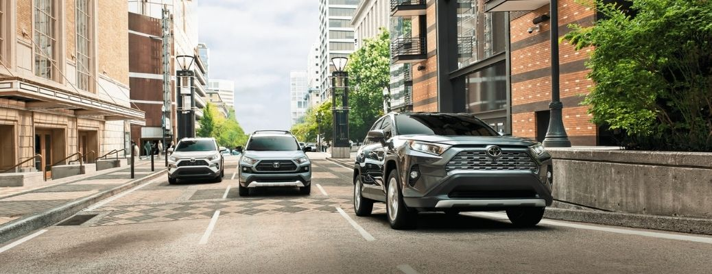three 2021 Toyota RAV4 Hybrid parked one after another in three different lanes