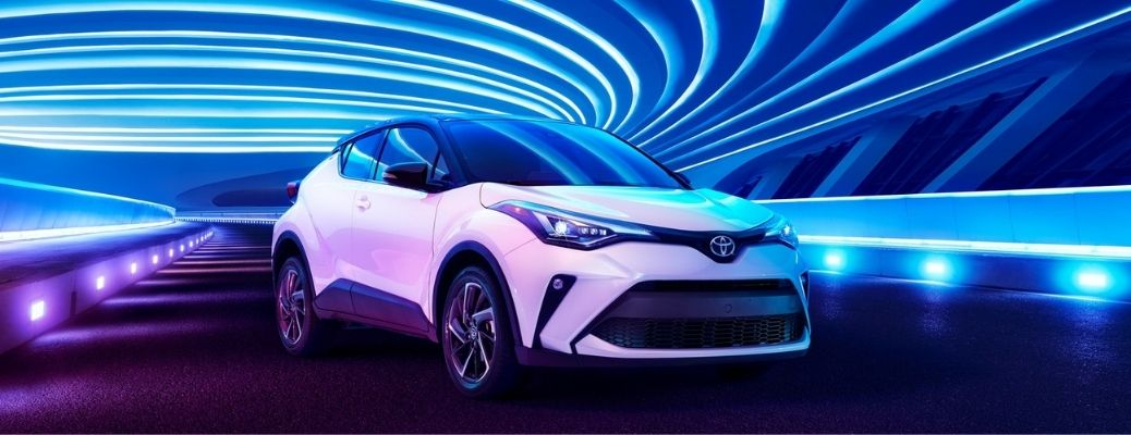 front quarter view of the 2021 Toyota C-HR parked under blue lights