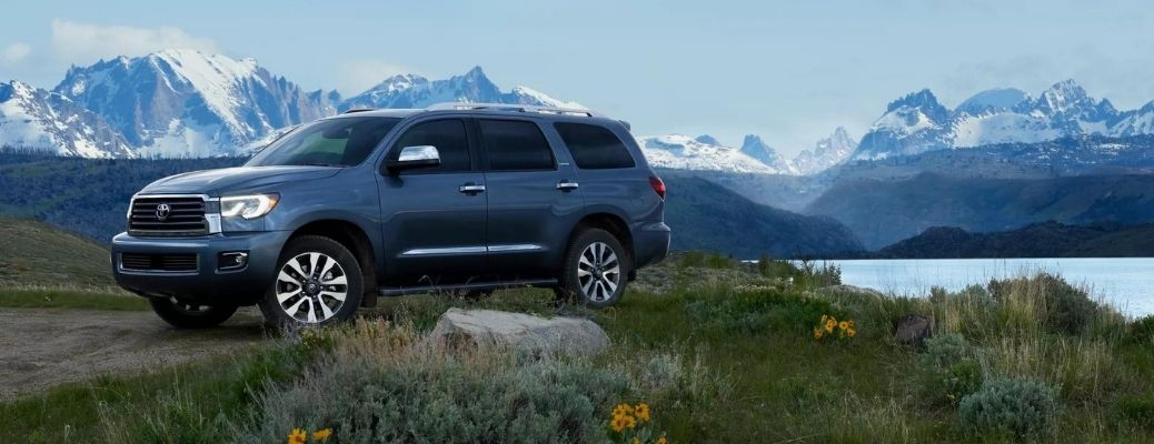 A 2022 Toyota Sequoia parked in front of landscape.