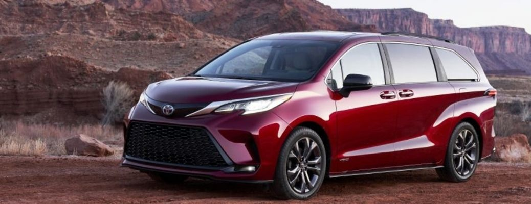 The 2021 Toyota Sienna parked on top of a rocky mountain.