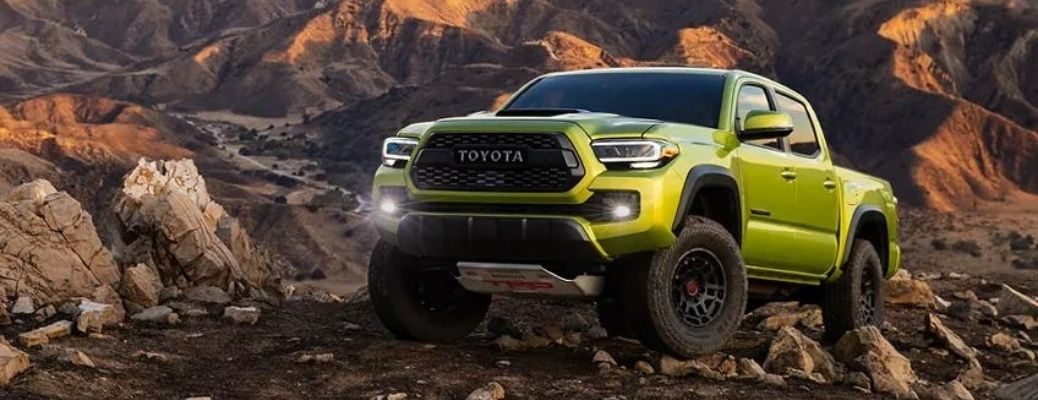 A 2022 Toyota Tacoma on the rocky terrain during day.
