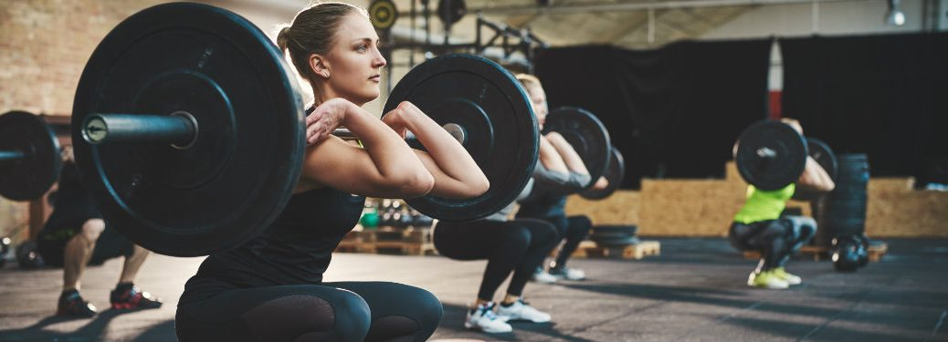 people lifting weights at a gym
