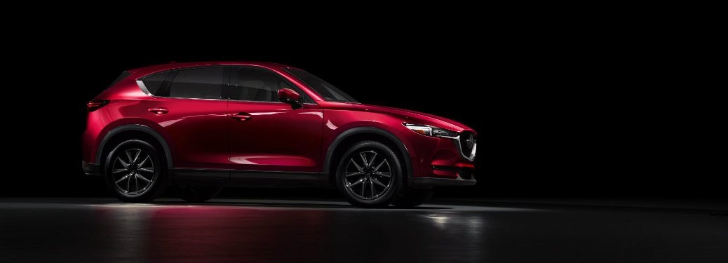 red mazda cx-5 parked in shadows